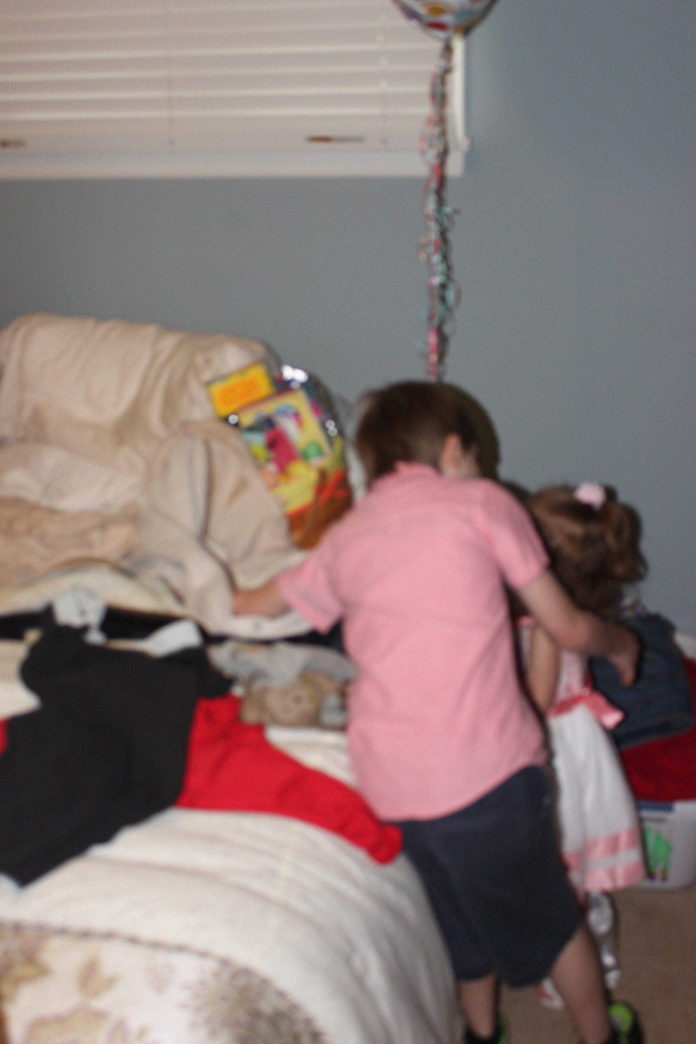 Blurry. Adry is helping Ella find her Easter basket.
